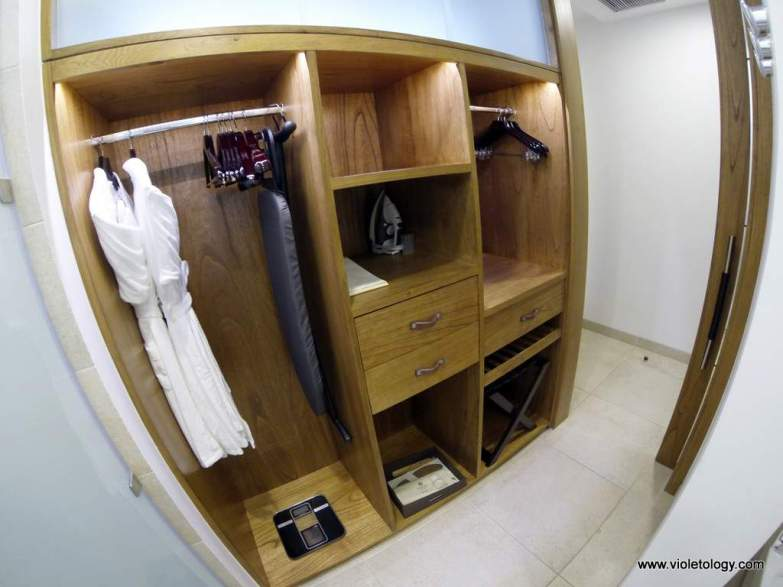 spacious cabinet within the bathroom area